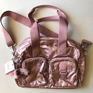7b10dff44e Kipling Bags - Kipling Defea Icy Rose Metallic Handbag
